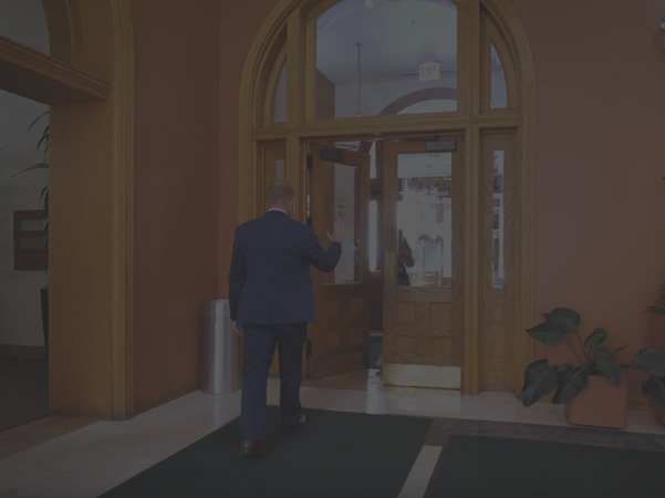 Man walking into a building